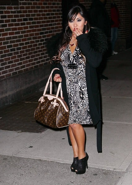 Television personality Nicole 'Snooki' Polizzi departs 'Late Show With David Letterman' at the Ed Sullivan Theater on February 10, 2011 in New York City.