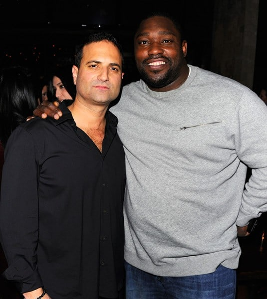 TEQA owner Derek Axelrod and Warren Sapp attend the grand opening of TEQA on February 24, 2011 in New York City.