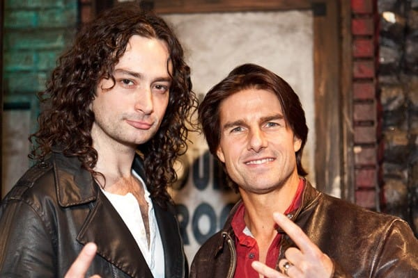 Actors Constantine Maroulis and Tom Cruise pose onstage for 'Rock of Ages' at the Pantages Theatre on February 19, 2011 in Hollywood, California.