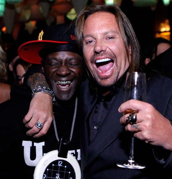 Flavor Flav of Public Enemy, Vince Neil and Carrot Top pose at Vince Neil's 50th birthday celebration at the Blush Boutique Nightclub inside the Wynn Las Vegas on February 5, 2011 in Las Vegas, Nevada.