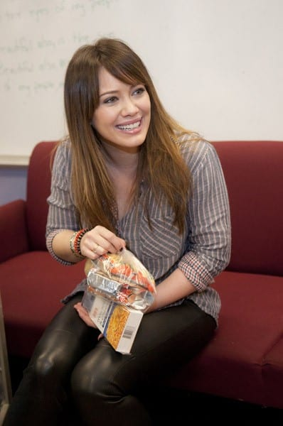 Hilary Duff helps pack lunches for the Blessings in a Backpack food program at Edward Jenner Elementary Academy of the Arts on March 23, 2011 in Chicago, Illinois.
