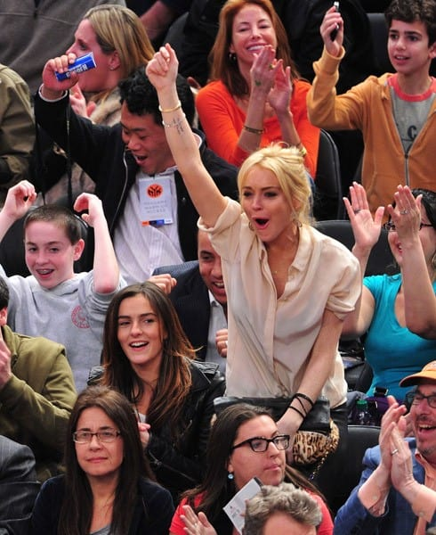 Lindsay Lohan attends the Memphis Grizzlies vs New York Knicks game at Madison Square Garden on March 17, 2011 in New York City.