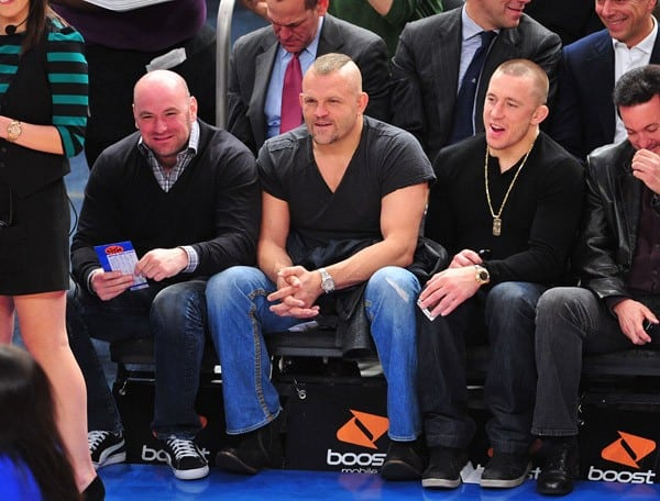 UFC fighters Dana White, Chuck Liddell and Georges St-Pierre attend the Memphis Grizzlies vs New York Knicks game at Madison Square Garden on March 17, 2011 in New York City.