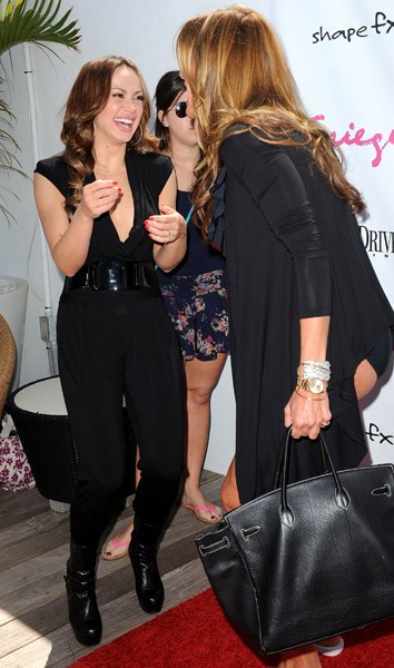 Karina Smirnoff and Kelly Killoren Bensimon attend the Spiegel Swim and Travel Launch Party at Gansevoort South on March 13, 2011 in Miami Beach, Florida.