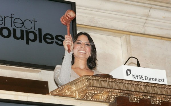 Olivia Munn rings the closing bell at the New York Stock Exchange on February 28, 2011 in New York City.