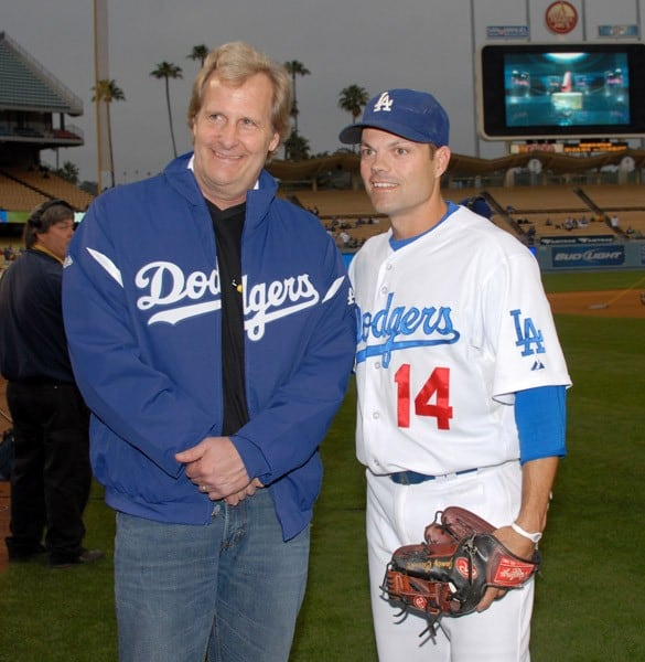Actor Jeff Daniels on the field with Dodgers player Jamey Carroll before The Los Angeles Dodgers game at Dodger Stadium on April 18, 2011 in Los Angeles, California.