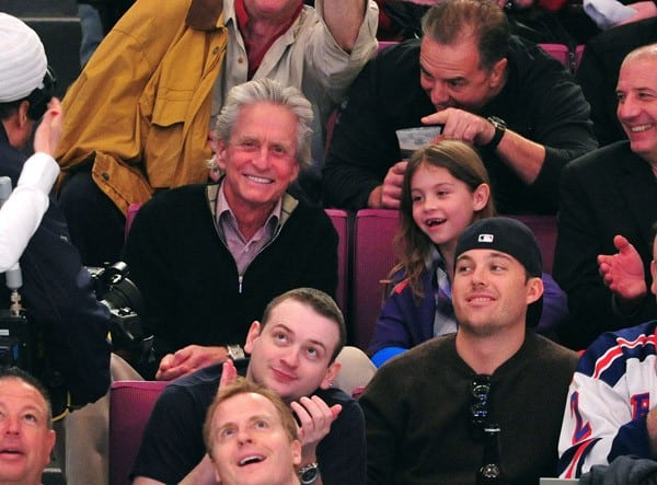 Michael Douglas and daughter Carys Zeta Douglas attend the Washington Capitals vs New York Rangers game at Madison Square Garden on April 17, 2011 in New York City.