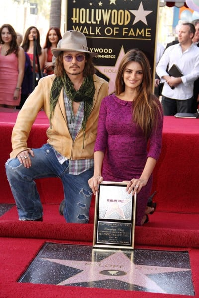 Johnny Depp with Penelope Cruz, who was Honored with a Star on The Hollywood Walk of Fame on April 1, 2011 in Hollywood, California.