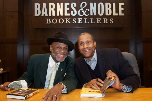 Michael Colyer and Tavis Smiley attend a book signing for Tavis Smiley's new book 'FAIL UP' at Barnes & Noble bookstore at The Grove on April 21, 2011 in Los Angeles, California.