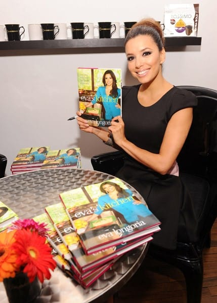 Actress Eva Longoria celebrates the grand opening of the Tassimo Brewbot Cafe, featuring the Tassimo single-cup home brewing system, on May 3, 2011 in New York City.