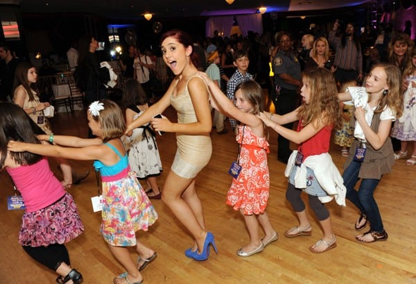 'Victorious' actress Ariana Grande dances in a line of children at a benefit for St. Jude Childrens Research Hospital at Peabody Hotel on May 14, 2011 in Memphis, Tennessee.