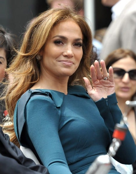 Marc Anthony, Simon Fuller and Jennifer Lopez attend the Simon Fuller Hollywood Walk Of Fame Induction Ceremony on May 23, 2011 in Hollywood, California.
