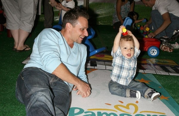 TV Personality Drew Lachey and son Hudson Lachey attend the Pampers 50th birthday celebration at SIR Stage 37 on June 16, 2011 in New York City.