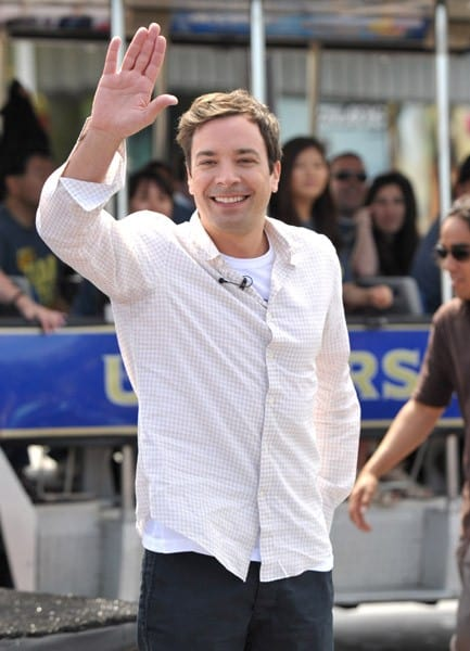 Actor Jimmy Fallon performs the new Universal Studio Tour theme song at Universal Studios Hollywood on June 2, 2011 in Universal City, California.