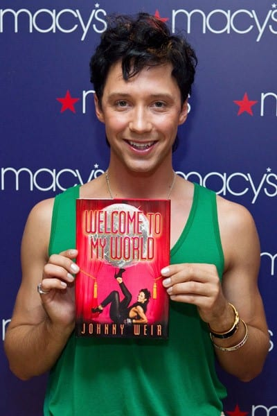 Two-time Olympic figure skater Johnny Weir signs copies of his book, 'Welcome to My World', at Macy's Metro Center on June 9, 2011 in Washington, DC.