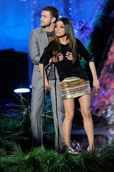 Justin Timberlake and Mila Kunis onstage during the 2011 MTV Movie Awards at Universal Studios' Gibson Amphitheatre on June 5, 2011 in Universal City, California.