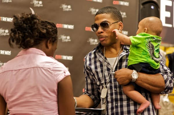 Rapper Nelly signs autographs during the Apple Bottoms by Nelly & CitiTrends in-store event on June 22, 2011 in Savannah, Georgia.