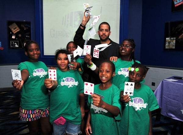 David Blaine surprises kids from Madison Square Garden's Garden of Dreams Foundation at Planet Hollywood on July 12, 2011 in New York City.