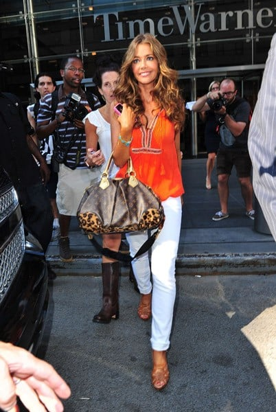 Denise Richards leaves the Time Warner Center at Columbus Circle on July 26, 2011 in New York City.