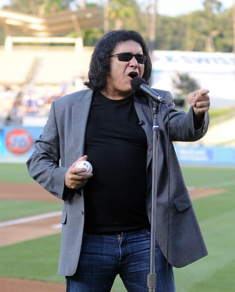 Gene Simmons throws out the ceremonial first pitch at Dodger Stadium on July 5, 2011 in Los Angeles, California.