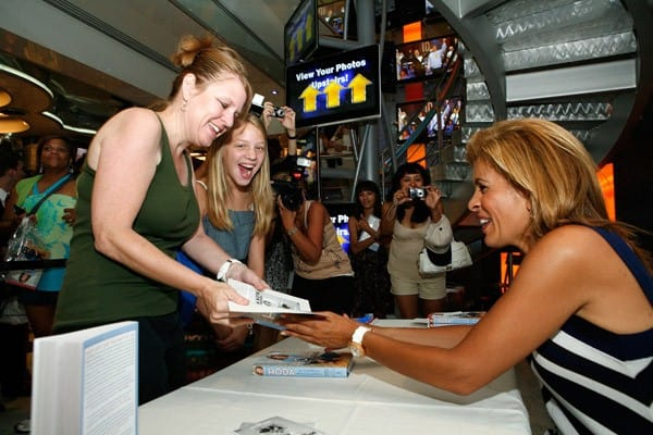 Hoda Kotb promotes 'Hoda: How I Survived War Zones, Bad Hair, Cancer, and Kathie Lee' at the NBC Experience Store on July 22, 2011 in New York City.