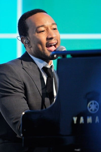 Recording artist John Legend speaks to invited guests at the press conference to announce the launch of the GIVE Education Campaign at the IAC Building on July 19, 2011 in New York City.