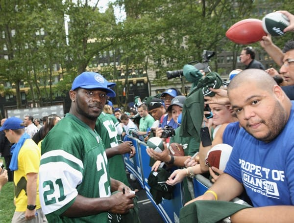 New York Jets quarterback Mark Sanchez, New York Jets runningback LaDainian Tomlinson, New York Giants coach Tom Coughlin and New York Giants quarterback Eli Manning during the MetLife Stadium celebration on August 26, 2011 in Bryant Park in New York City