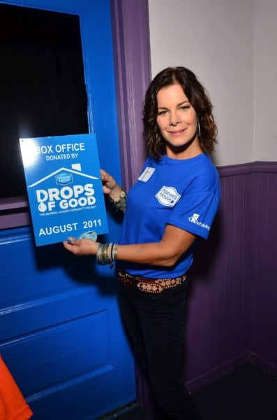 Marcia Gay Harden helps volunteers renovate the Philadelphia Community Center on August 16, 2011 in Philadelphia, Pennsylvania.