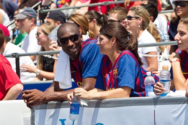 Los Angeles Lakers guard Kobe Bryant and Mia Hamm talk on the bench at the 2011 Celebrity Soccer Challenge at Kastles Stadium at the Wharf on July 31, 2011 in Washington, DC.