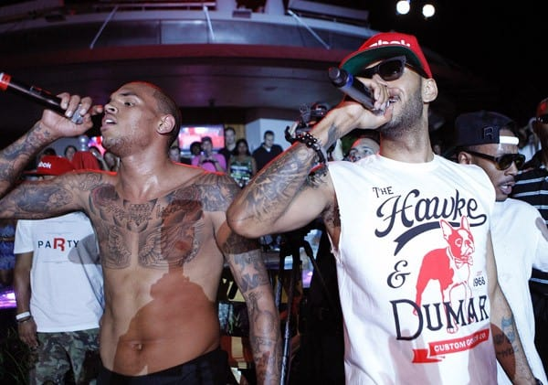 Chris Brown and Swizz Beatz perform during the Reebok Classics party at Project on August 22, 2011 in Las Vegas, Nevada.