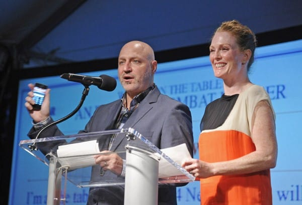 Celebrity chef Tom Colicchio and actress Julianne Moore speak at 'What's On The Table', an event to combat hunger, hosted by Vanity Fair and the United Way of NYC at a Private Residence on August 20, 2011 in Sagaponack, New York.