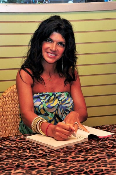 TV personality Teresa Giudice promotes 'Fabulicious' at Lola's Boutique on August 4, 2011 in Point Pleasant Beach, New Jersey.