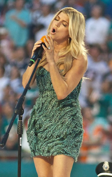 Fergie performs 'The National Anthem' prior to the Monday Night Football game between the Miami Dolphins and New Engalnd Patriots at Sun Life Stadium on September 12, 2011 in Miami Gardens, Florida.