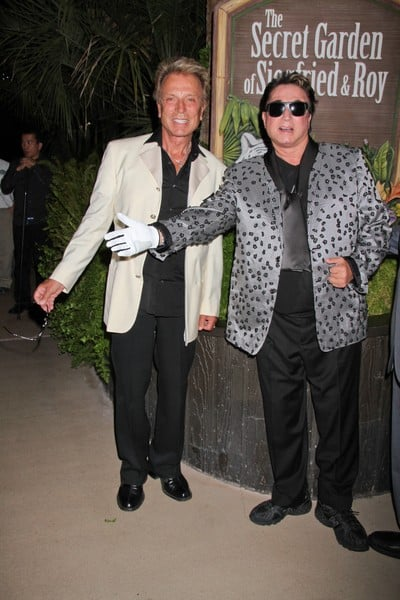 Roy Horn and Siegfried Fischbacher attend Roy Horn's 67th Birthday Celebration at Siegfried & Roy's Secret Garden and Dolphin Habitat at the Mirage in Las Vegas, Nevada on October 2, 2011