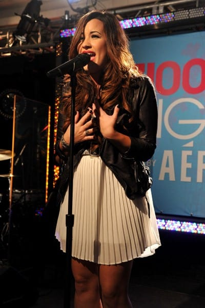Singer Demi Lovato performs onstage at Z100's Jingle Ball 2011 Official Kick Off Party presented By Aeropostale at Aeropostale Times Square on October 21, 2011 in New York City.