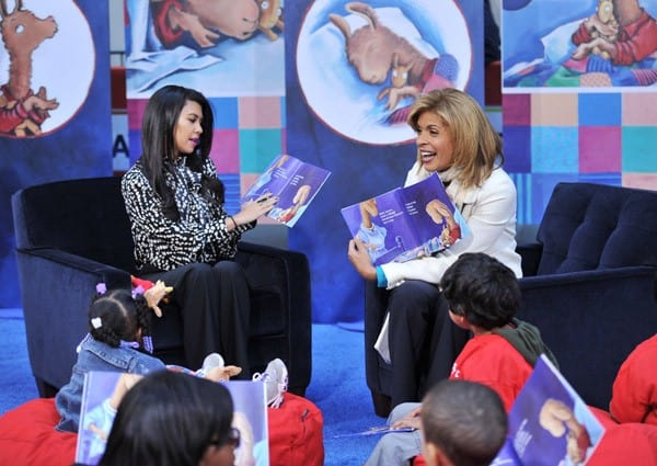 TV personality Kourtney Kardashian and host Hoda Kotb read to children as part of Jumpstart's Read For The Record at NBC's TODAY Show on October 6, 2011 in New York City.