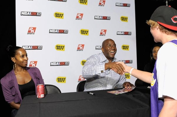 NBA legend Earvin 'Magic' Johnson greets fans at the NBA 2K12 Launch Event at the Best Buy in West LA on October 3, 2011 in Los Angeles, California.