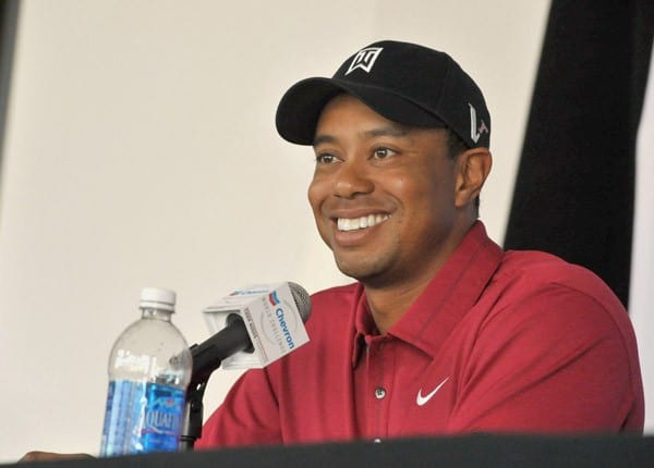 -Host of the Chevron World Challenge Tiger Woods makes press announcement for 2011 Field and Putt with local fans held at the Hollywood & Highland Courtyard on October 11, 2011 in Hollywood, California.