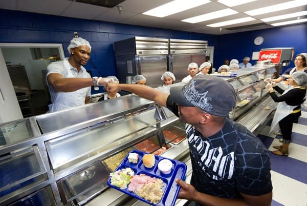 Chris Bosh serves Thanksgiving meal at Chapman Partnership on November 23, 2011 in Miami, Florida.