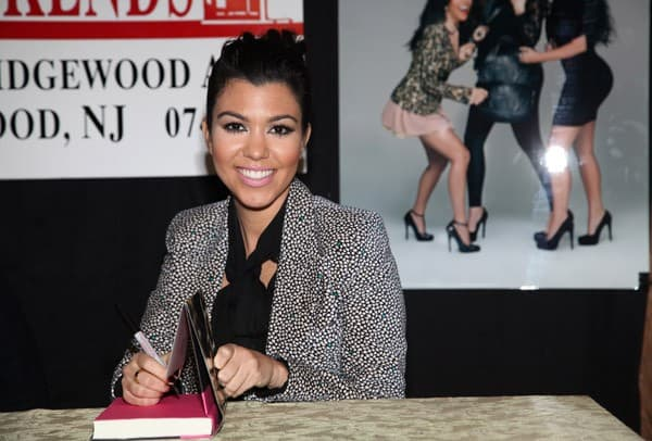 "Khloe Kardashian and Kourtney Kardashian promote the new book ""Dollhouse"" at Bookends Bookstore on November 16, 2011 in Ridgewood, New Jersey."
