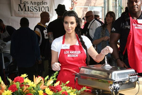 Kirk Douglas, Zoe Saldana, Kim Kardashian and Jennifer Love Hewitt attend the 75th Anniversary of Los Angeles Mission serving Thanksgiving dinner to the homeless at Los Angeles Mission on November 23, 2011 in Los Angeles, California.