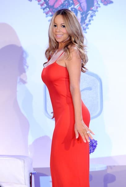 Singer Mariah Carey poses for Jenny Craig to celebrate new relationship with the American Heart Association and Mariah Carey at Four Seasons Hotel New York on November 9, 2011 in New York City.