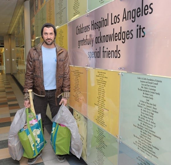 Dancer Maksim Chmerkovskiy delivers hundreds of toys to Children's Hospital Los Angeles as part of the Cost Plus World Market 'Share the Joy' campaign at Children's Hospital Los Angeles on November 18, 2011 in Los Angeles, California.