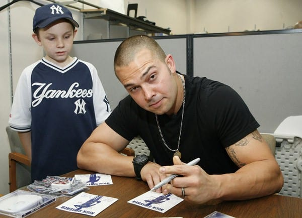 Nick Swisher promotes 'Believe' at the J&R Music and Computer World on November 19, 2011 in New York City.