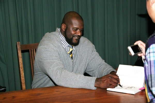 Retired NBA player Shaquille O'Neal signs copies of his new book 'Shaq Uncut: My Story' at Vroman's Bookstore on November 28, 2011 in Pasadena, California.