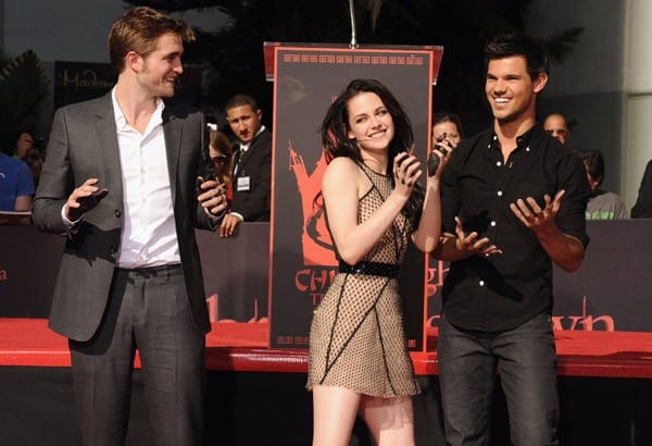 Actors Robert Pattinson, Kristen Stewart and Taylor Lautner attend their Hand and Footprint Ceremony at Grauman's Chinese Theatre on November 3, 2011 in Hollywood, California.