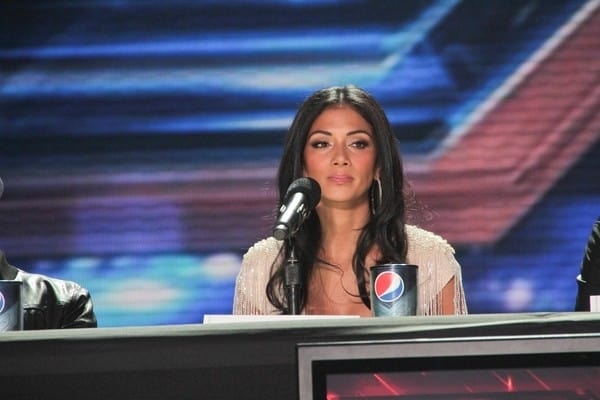 Simon Cowell and Nicole Scherzinger Attend 'The X Factor' Press Conference on December 19, 2011 in Los Angeles, California