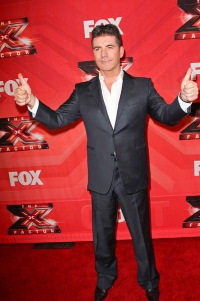 Simon Cowell, Steve Jones, L.A. Reid Arrives to 'The X Factor' Season Finale in Los Angeles, California on December 22, 2011