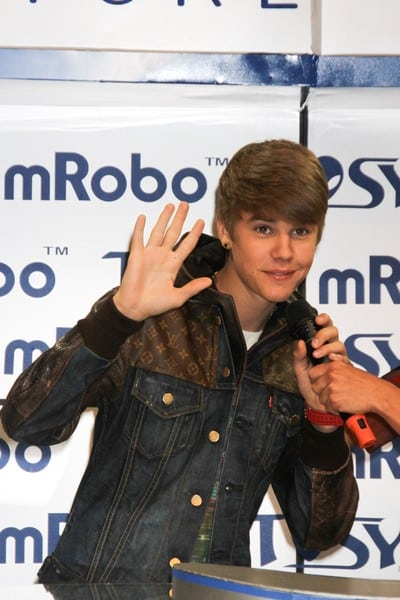 Justin Bieber Unveils the 'mRobo' Bass Portable Speaker & Dancing Robot at the TOSY Robotics Booth During Day #3 of the 2012 International Consumer Electronics Show in Las Vegas, Nevada on January 12, 2012