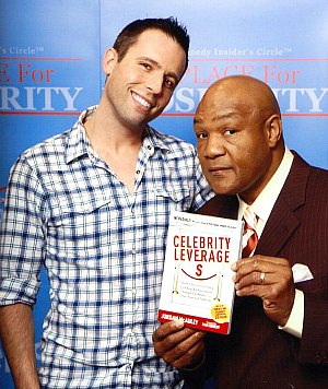 'Celebrity Leverage' author Jordan McAuley with George Foreman
